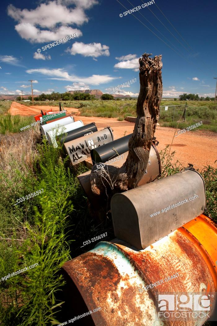 Stock Photo: A row of individual mailboxes is grouped at the entrance to a rural road in Cane Beds, AZ.
