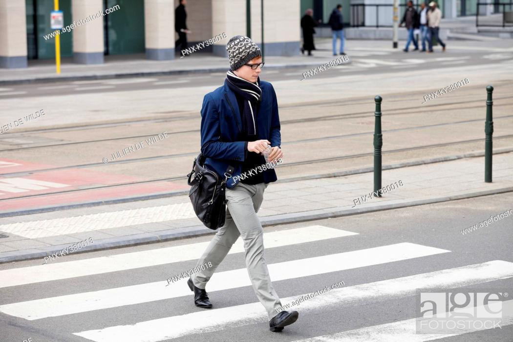 Stock Photo: Businessman crossing the road.