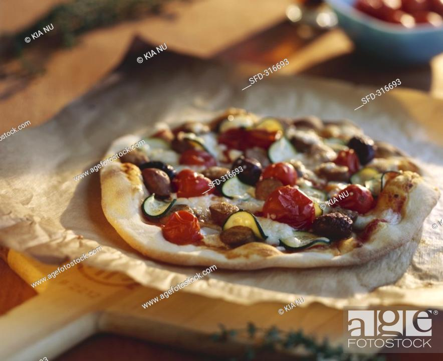 Stock Photo: Pizza topped with merguez sausage and black olives.