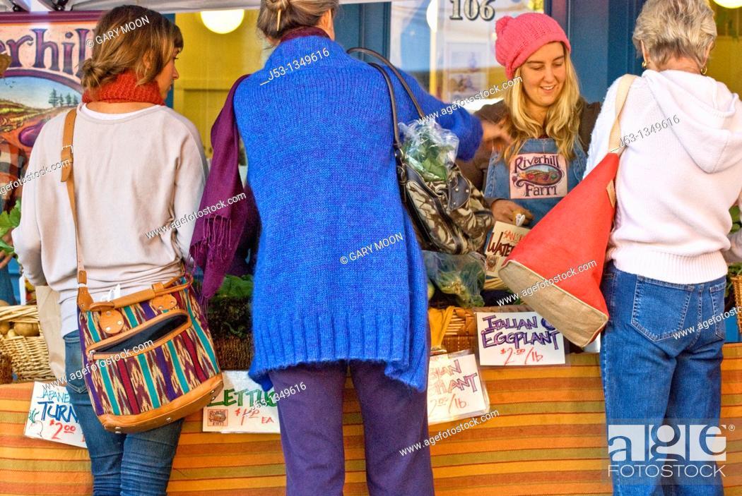 Stock Photo: Women shopping at outdoor farmer's market, Nevada City, California.