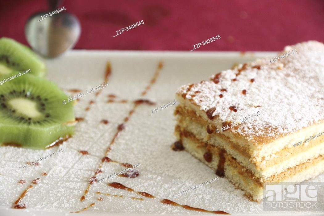 Stock Photo: sweet dessert, a piece of tart and slices of kiwi.