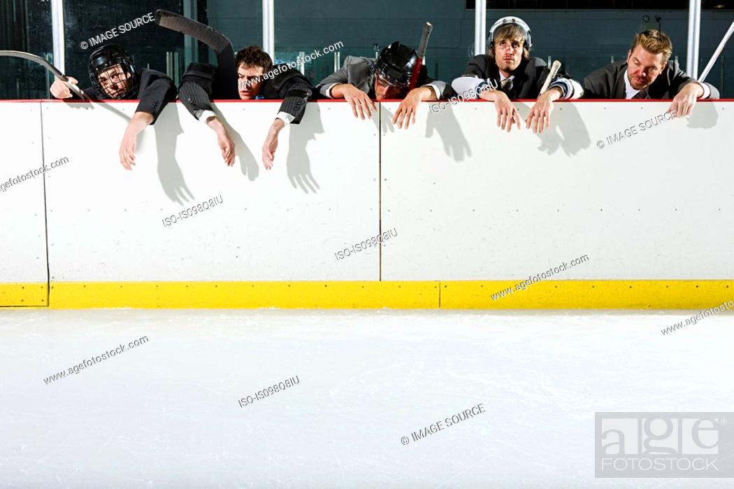 Stock Photo: Businessmen playing ice hockey.