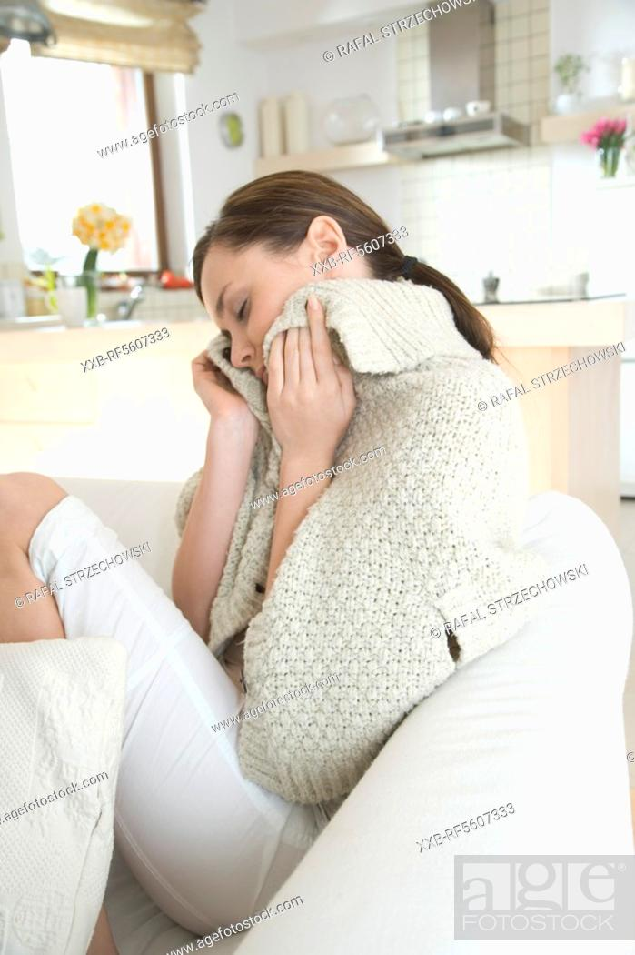 Stock Photo: woman worming herself.