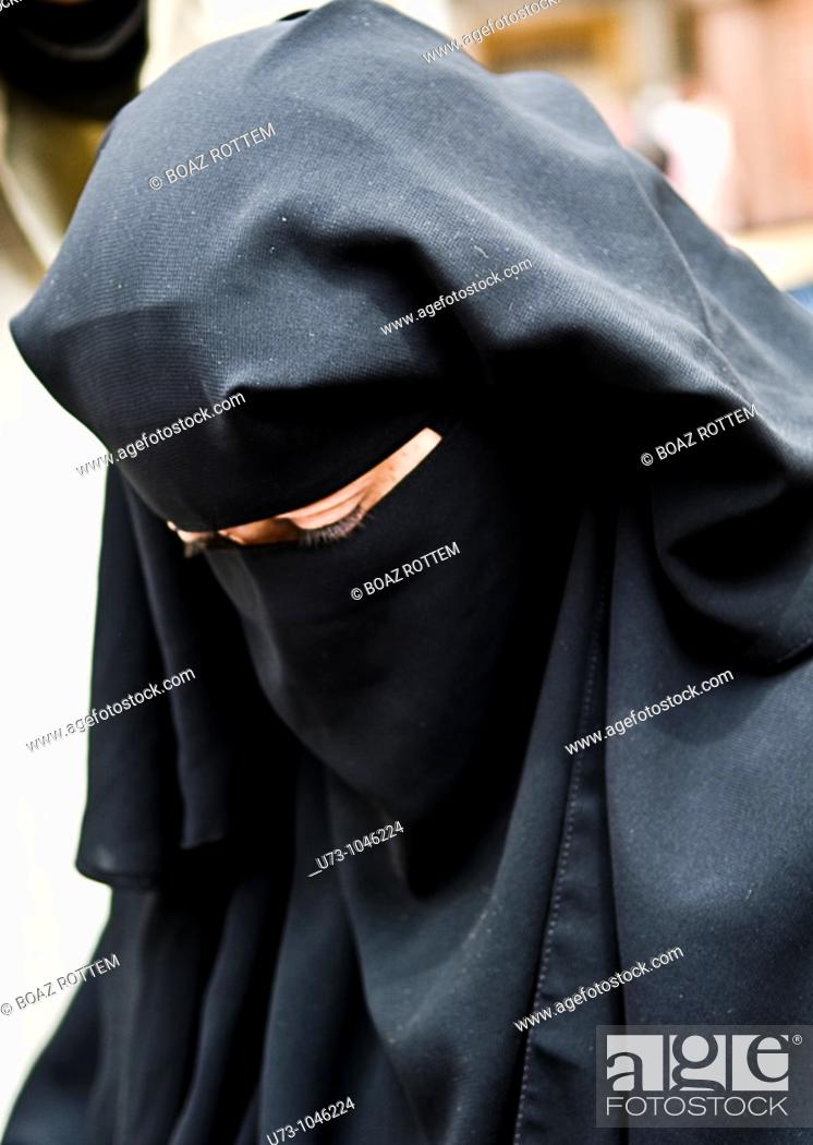 Stock Photo: A veiled woman in Egypt.