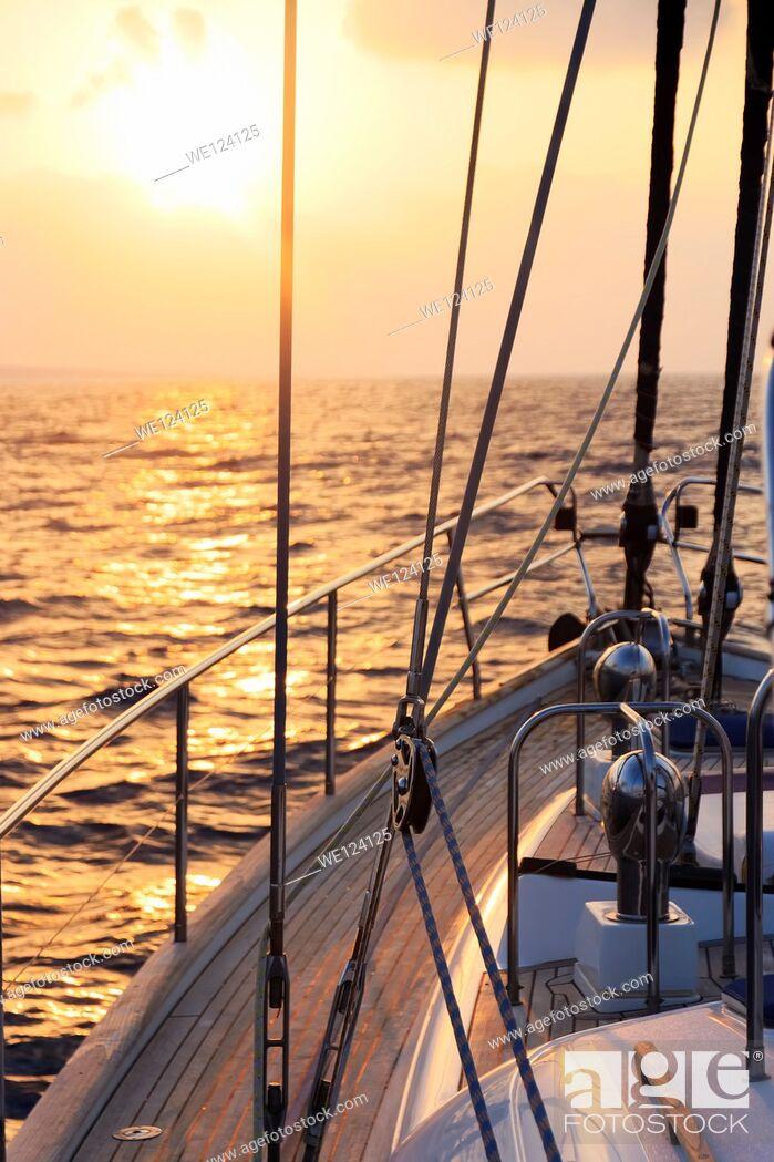 Stock Photo: Yacht sailing at sunset along Akamas peninsula, Cyprus.