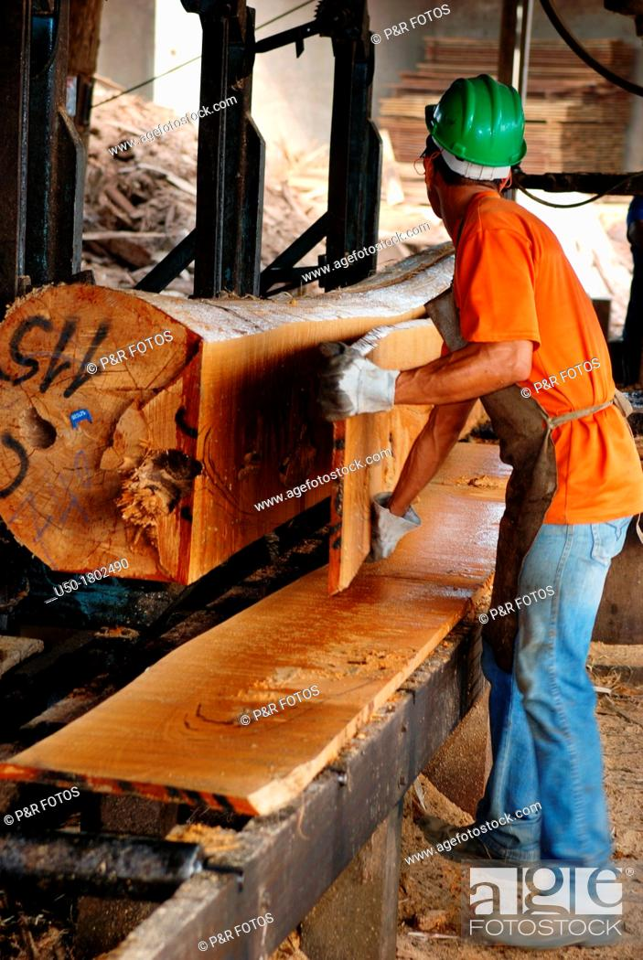 Stock Photo: Worker riving log in a sawmill, Rio Branco, Acre, 2011.