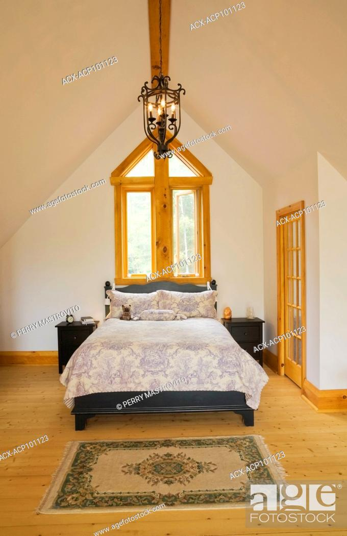 Stock Photo Queen Size Bed With Wooden Charcoal Coloured Headboard And Footboard In Master Bedroom On The Mezzanine Inside A Cottage Style Log Cabin
