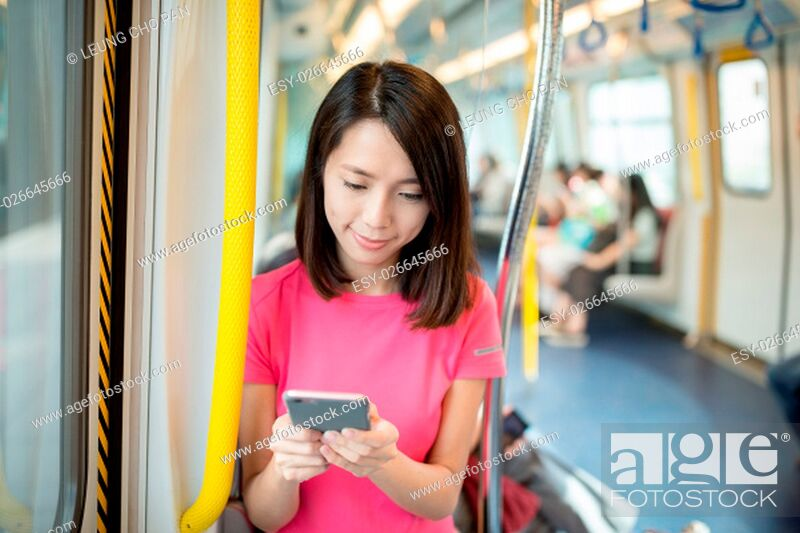 Stock Photo: Woman sending sms on cellphone in train compartment.