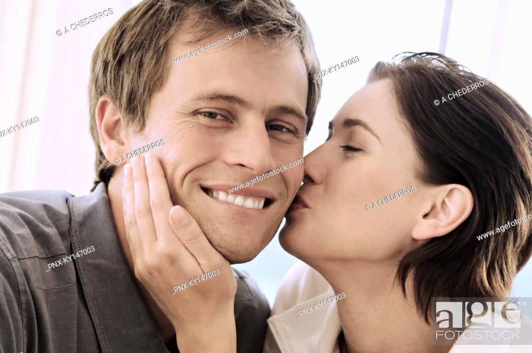 Stock Photo: Portrait of woman kissing man.