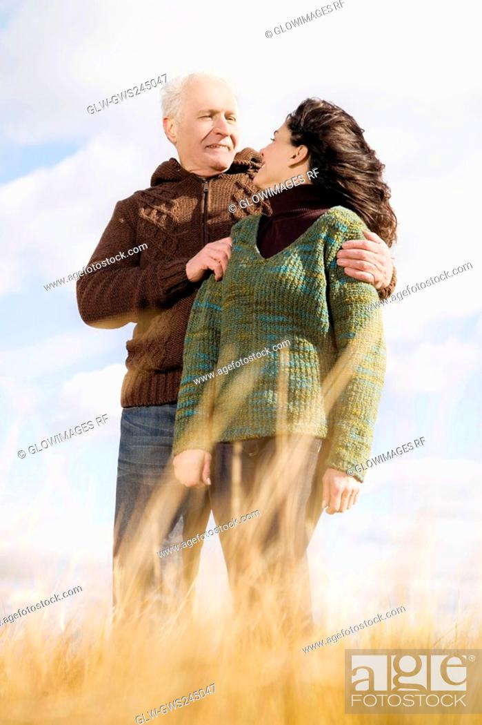Stock Photo: Couple standing on the beach and smiling.
