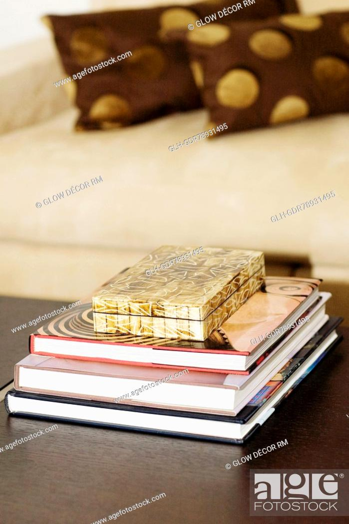 Photo de stock: Stack of books on a table.
