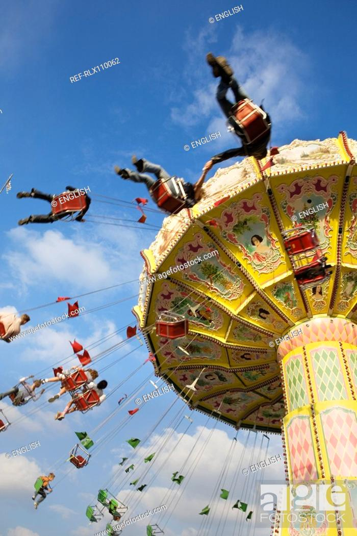 Stock Photo: People riding on carousel at Oktoberfest beer festival in Munich, Germany.