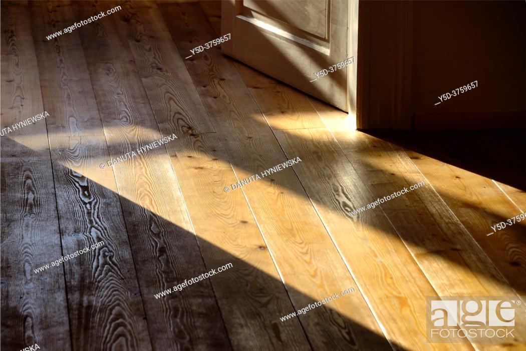 Stock Photo: Old fashion interior scene, open wooden door, sunshine on wooden floor.