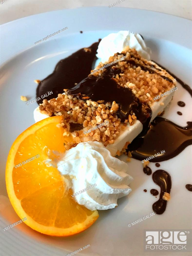 Stock Photo: Fig cake with chocolate sauce, cream and orange.