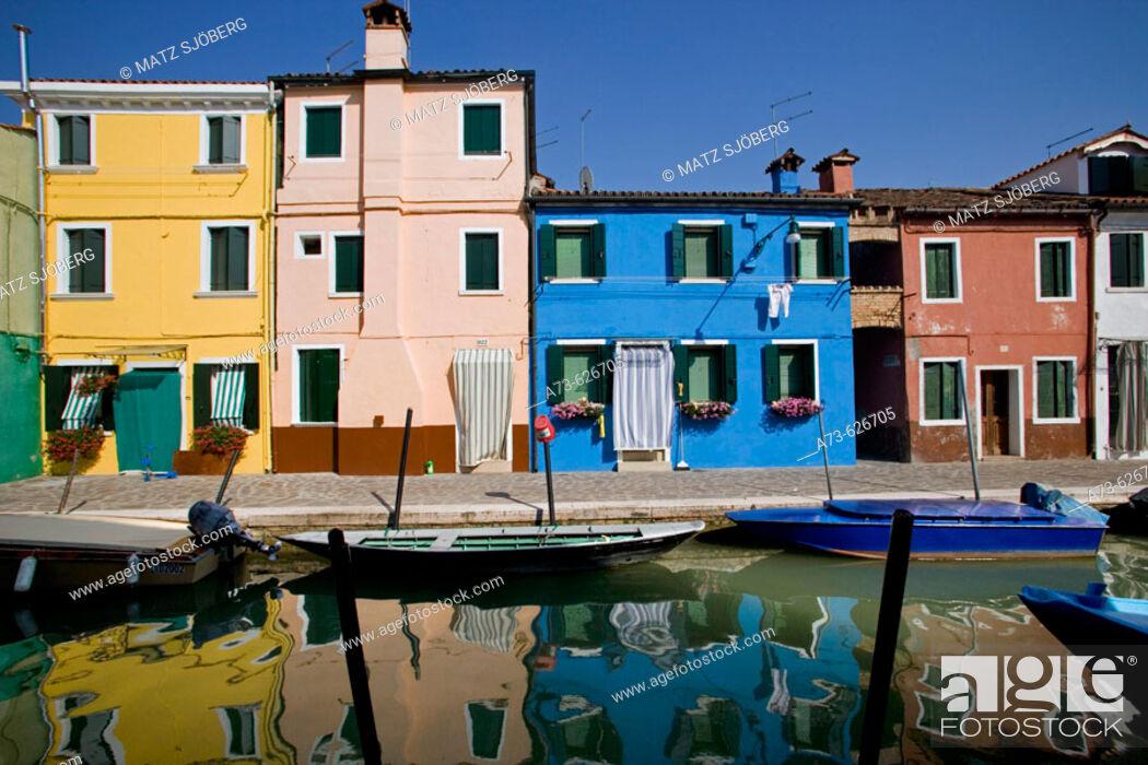Stock Photo: Laguna (lagoon) di Venezia. Burano. A canal with the typical colourful houses. Venice. Italy.