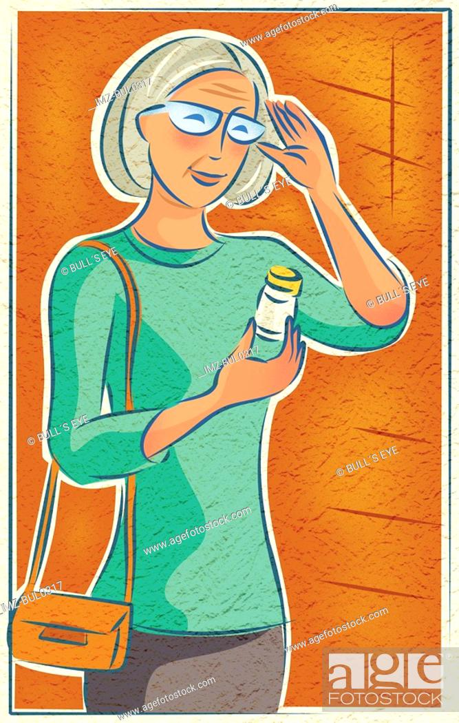 Stock Photo: An elderly woman looking at her medication bottle.