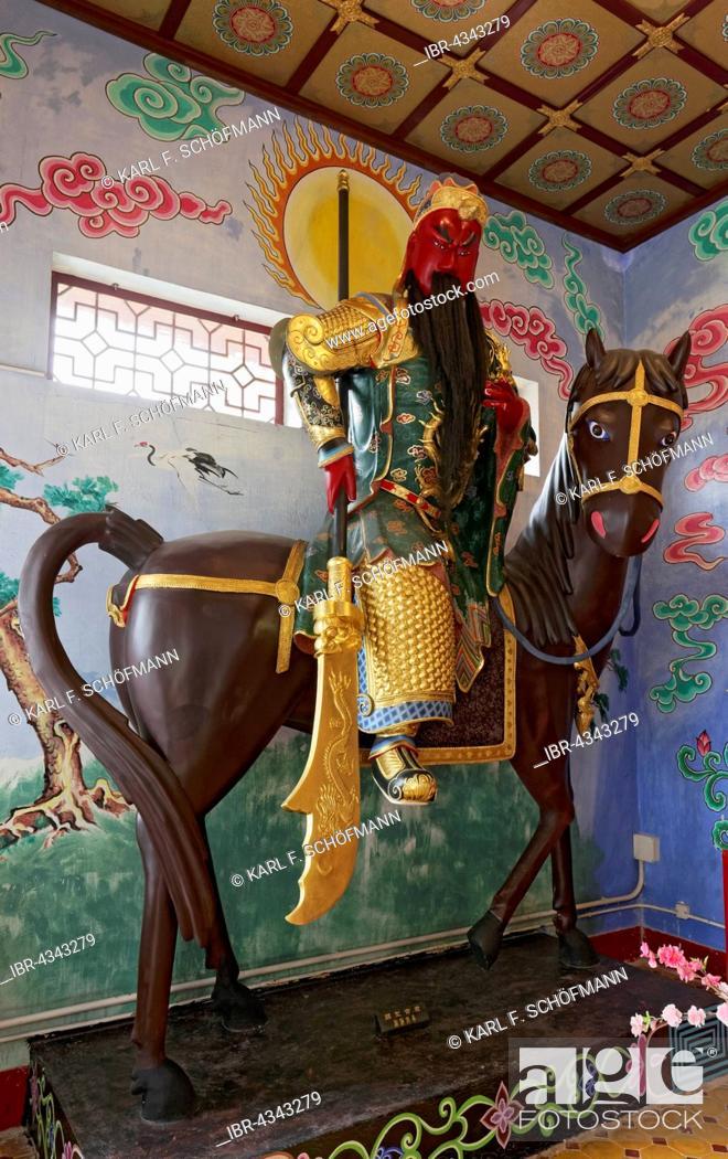 Stock Photo: Figure of a Bodhisattva on horseback, Buddhist Avalokitesvara or Kwun Yam Temple, Ten Thousand Buddhas Monastery, Sha Tin, New Territories, Hong Kong, China.