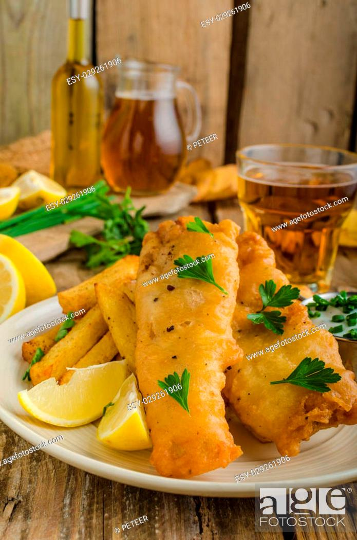 Stock Photo: Fish and chips. Fish wrapped in beer batter, herbs dip and czech beer.