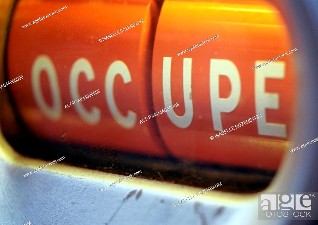 Stock Photo: 'Occupied' text in French, close-up.