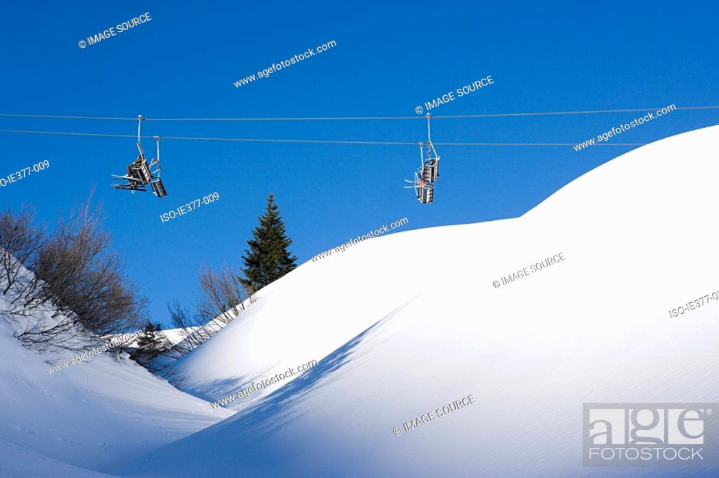 Stock Photo: People on a ski lift.