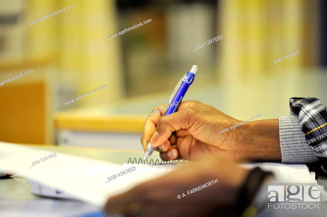 Stock Photo: Student taking notes in classroom. Stockholm, Sweden.