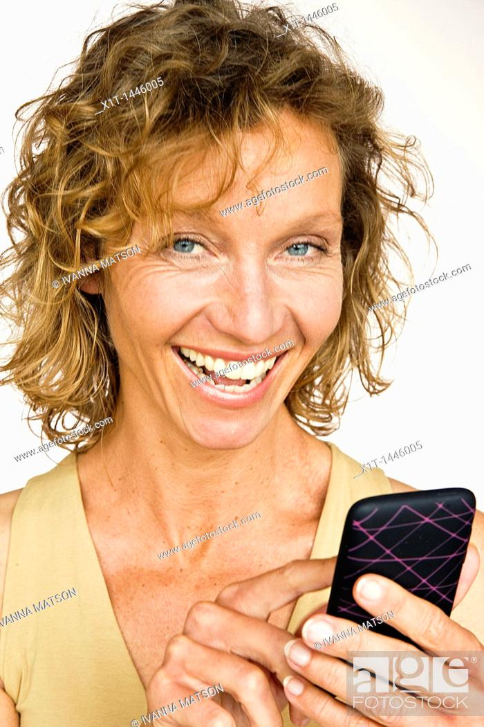 Stock Photo: Woman with smartphone.