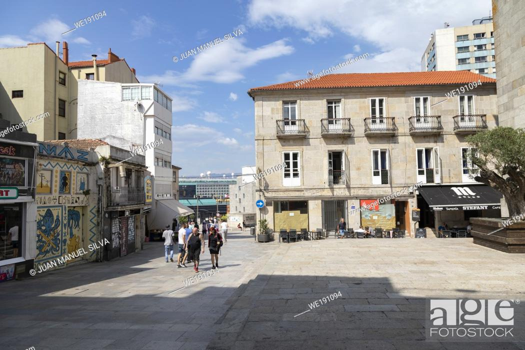 Stock Photo: People walking on Praza Igrexa street, Old downtown Vigo, Ponteverda, Galicia, Spain.