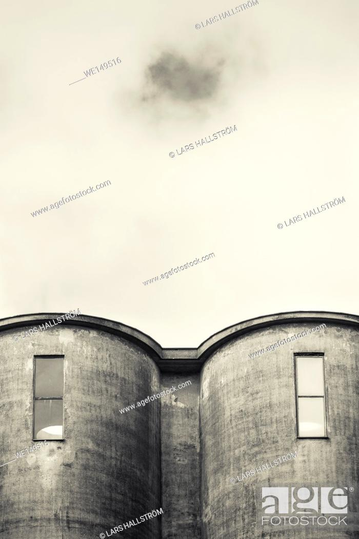 Stock Photo: Exterior of old industrial building. Concrete architecture. Abandoned factory.
