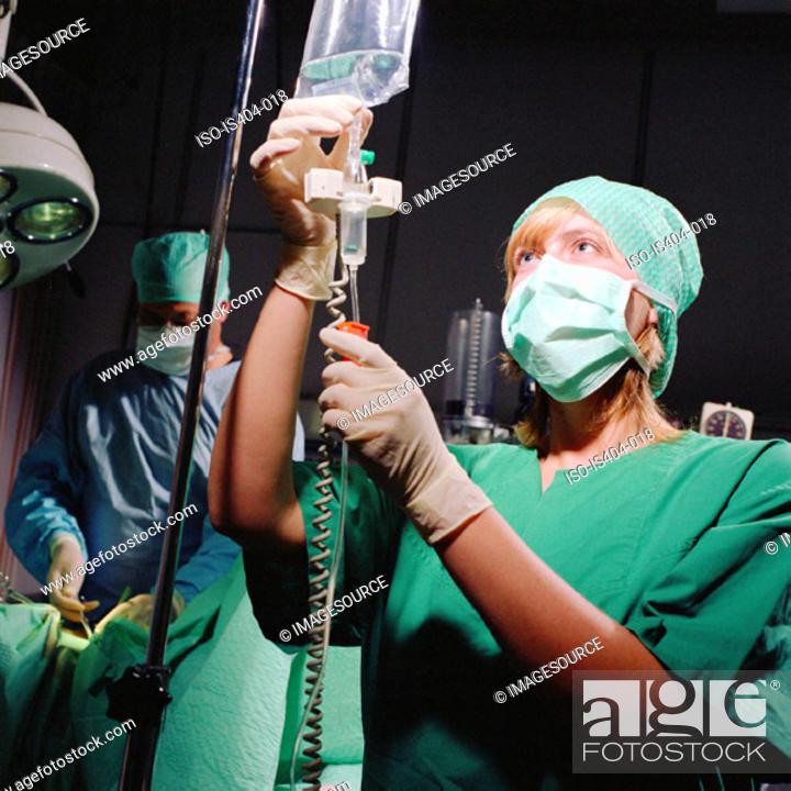Stock Photo: Nurse monitoring fluids.