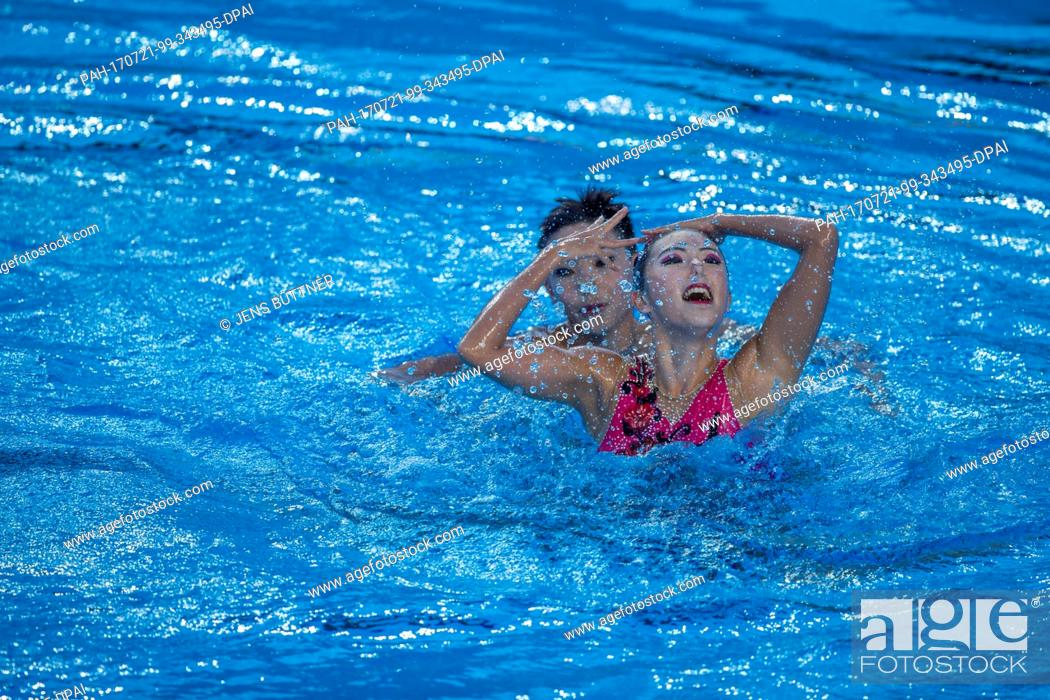 Stock Photo: Shuwen Zheng and Haoyu Shi from China in action in the mixer duet free qualification round of the FINA World Championships 2017 in Budapest, Hungary.