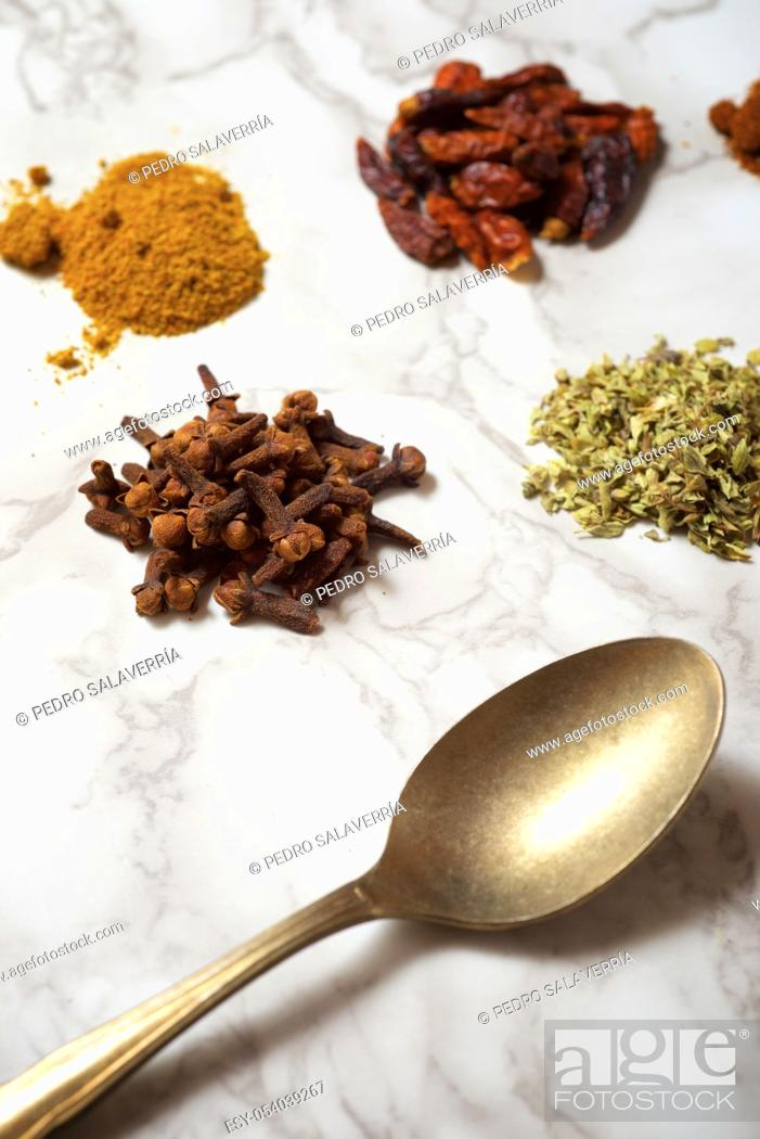 Stock Photo: Spices on a marble table.