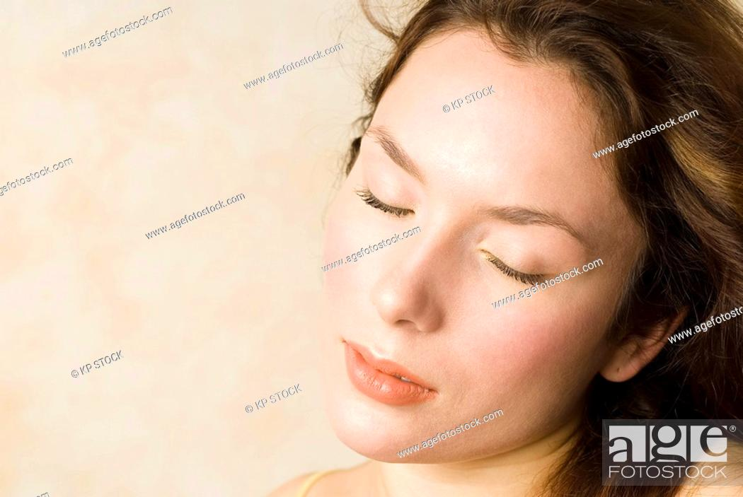 Stock Photo: Young woman, Eyes closed, portrait, close up.