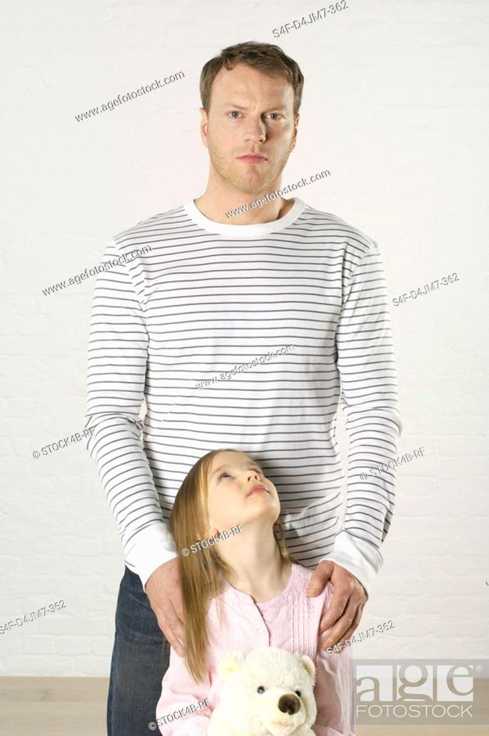 Stock Photo: Girl looking up to father.