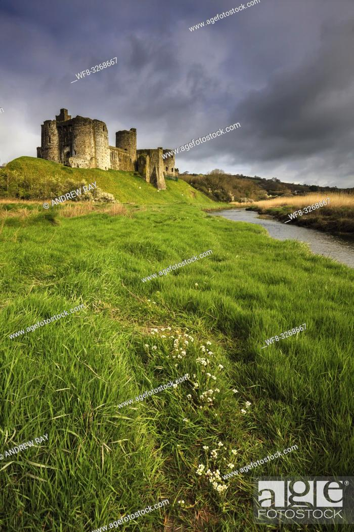 Stock Photo: The Norman Castle on the banks of the Gwendraeth Fach in the Carmarthenshire town of Kidwelly, captured on a stormy morning in April.