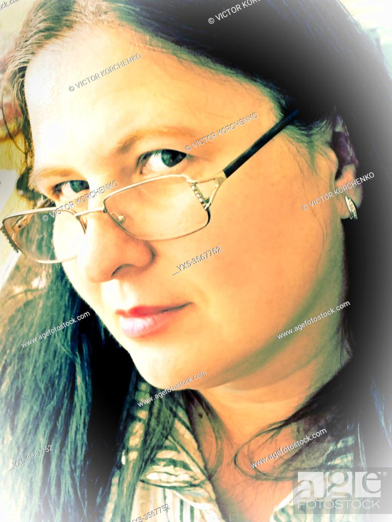 Stock Photo: Portrait of a woman wearing spectacles.