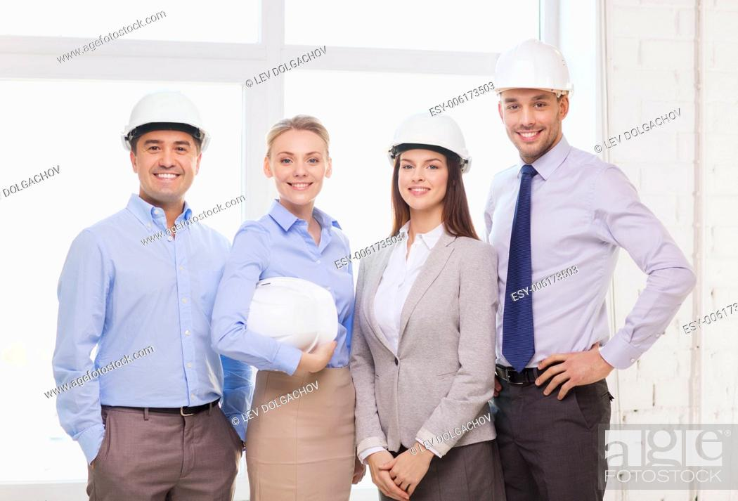 Photo de stock: business, architecture and office concept - happy team of architects in office.