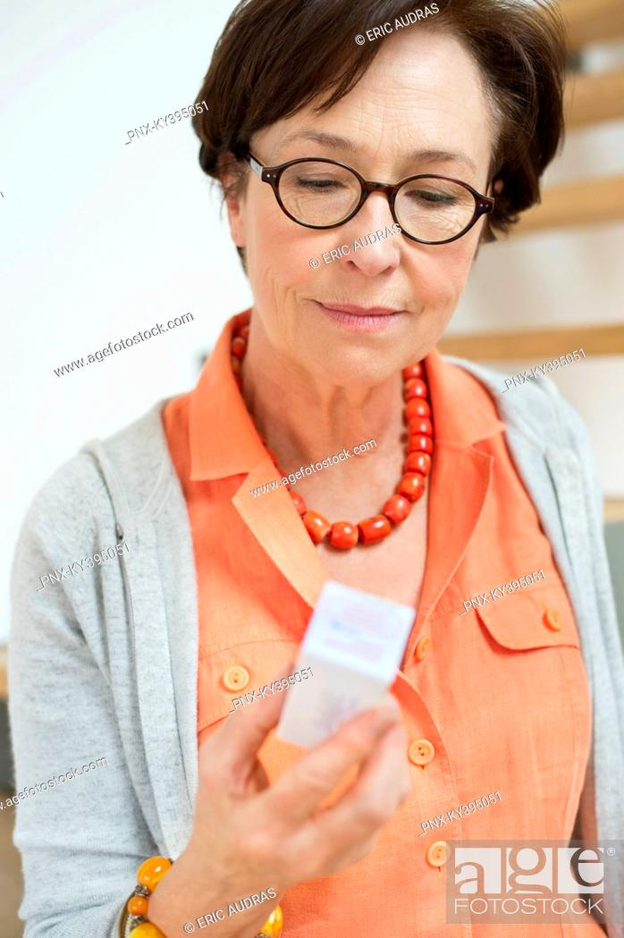 Stock Photo: Woman reading a prescription.