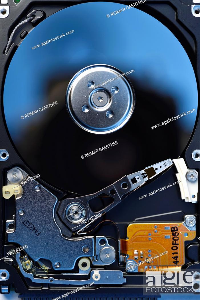 Stock Photo: Open SATA hard disk drive data storage electronic device.