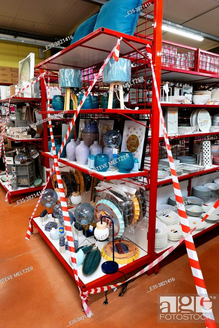Stock Photo: During the COVID confinement in France a general purpose store has sections cordoned off as not for sale if they competed with a single purpose enterprise.