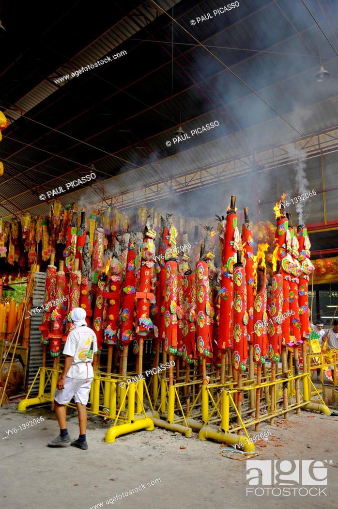 Stock Photo: Devotees burning large candles,Vegetarian festival at San Jao Sieng Kong shrine , wat sung heng yee, Chinatown , Bangkok,.
