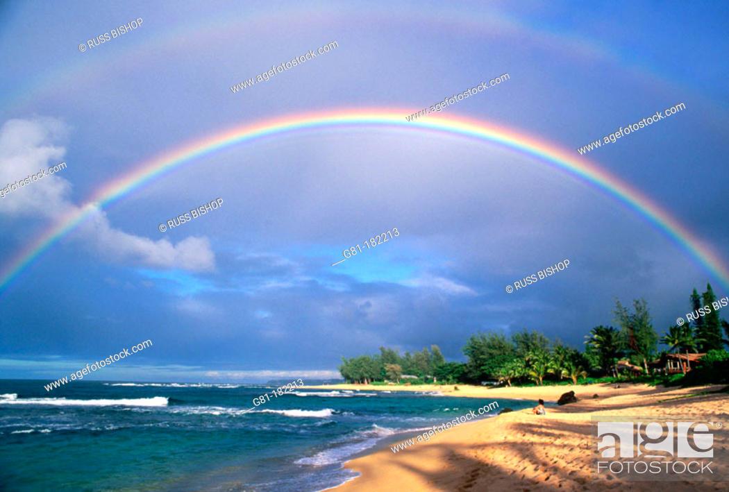 Stock Photo: Double rainbow and evening light on Tunnels Beach, North Shore, Island of Kauai, Hawaii.