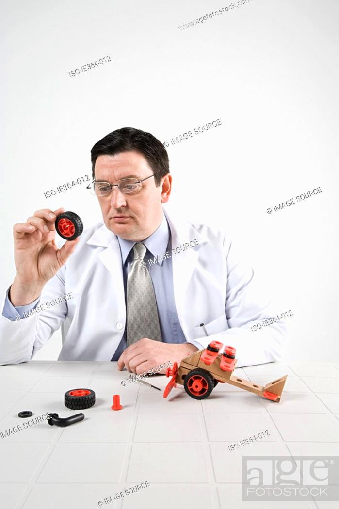 Stock Photo: Scientist with model helicopter.