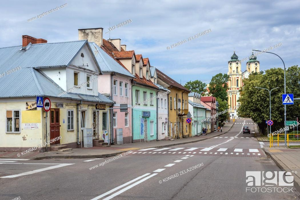 Stock Photo: Main street with Basilica of Visitation of Blessed Virgin Mary in former Dominican monastery in Sejny town located in Podlaskie Voivodeship, Poland.