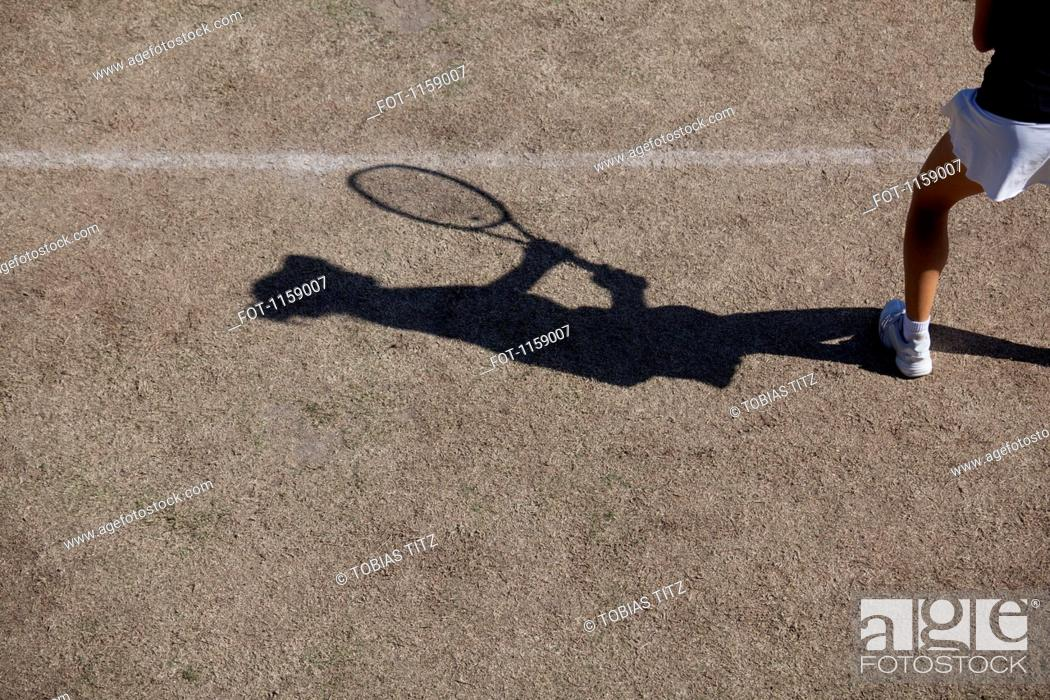 Stock Photo: Shadow of tennis player.