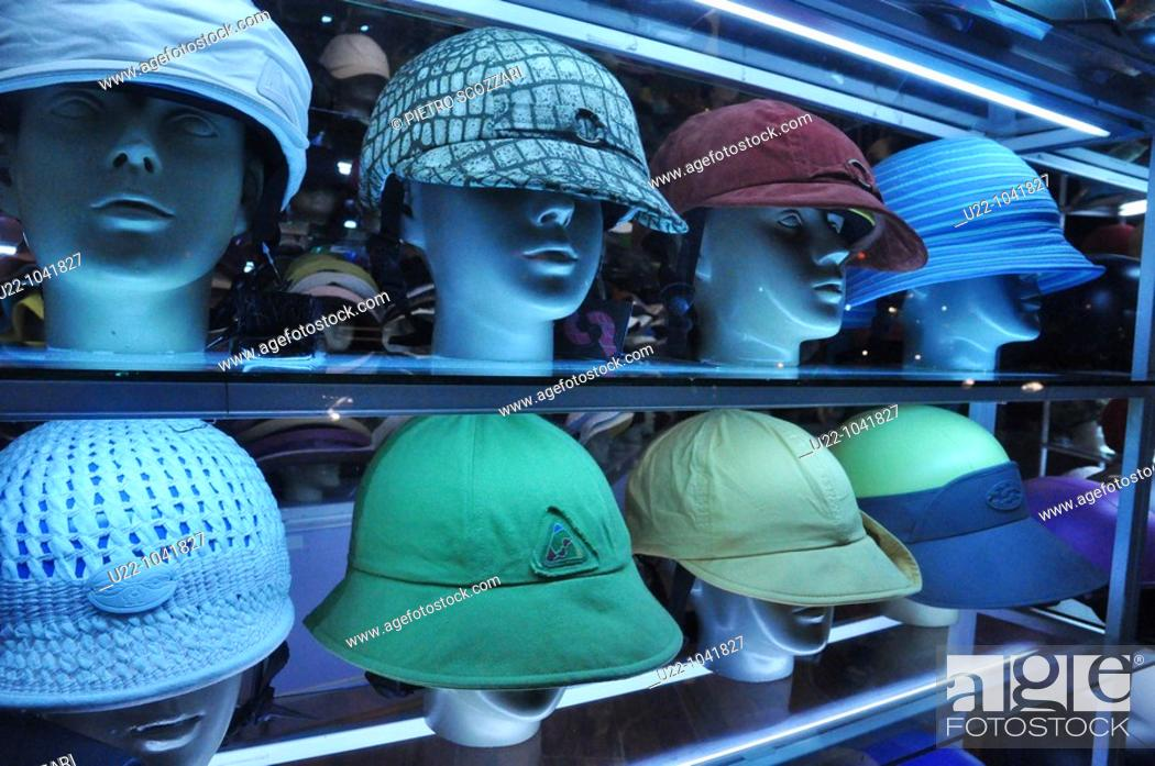 Stock Photo: Hanoi (Vietnam): fancy helmets for motor-bikes drivers sold in a shop.