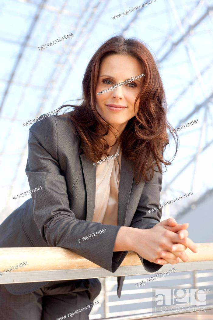 Stock Photo: Germany, Leipzig, Businesswoman smiling, portrait.