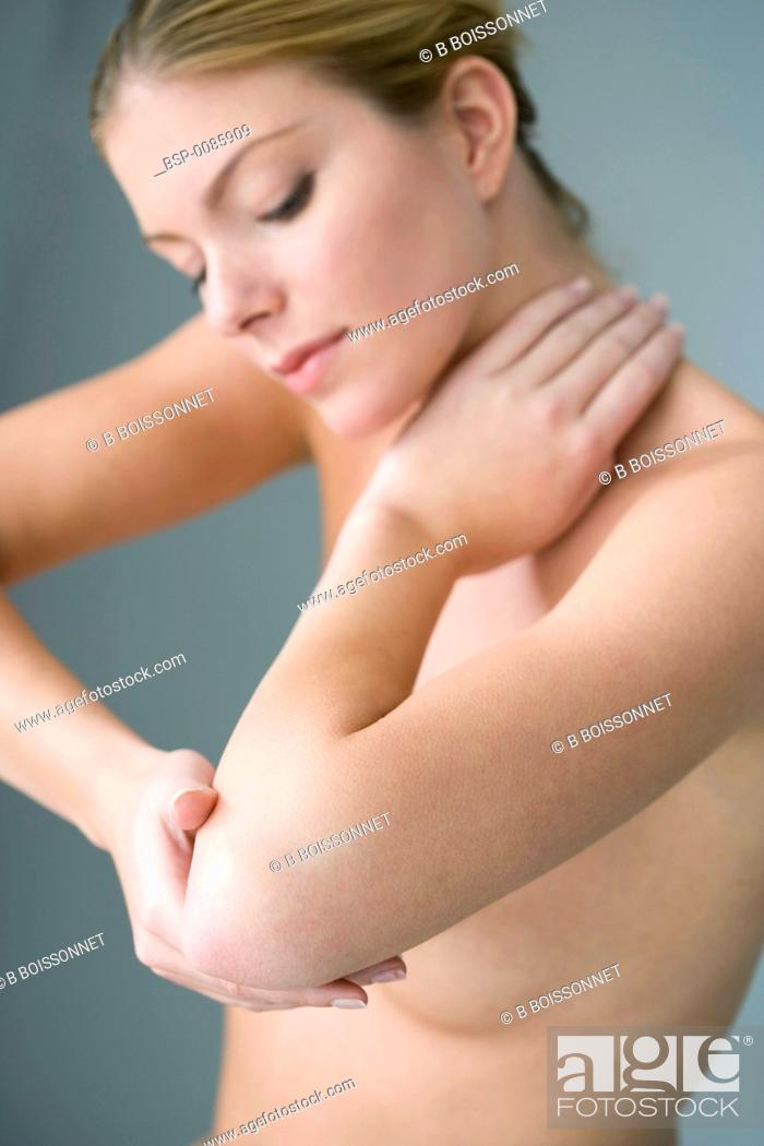 Stock Photo: ELBOW PAIN IN A WOMAN Model.