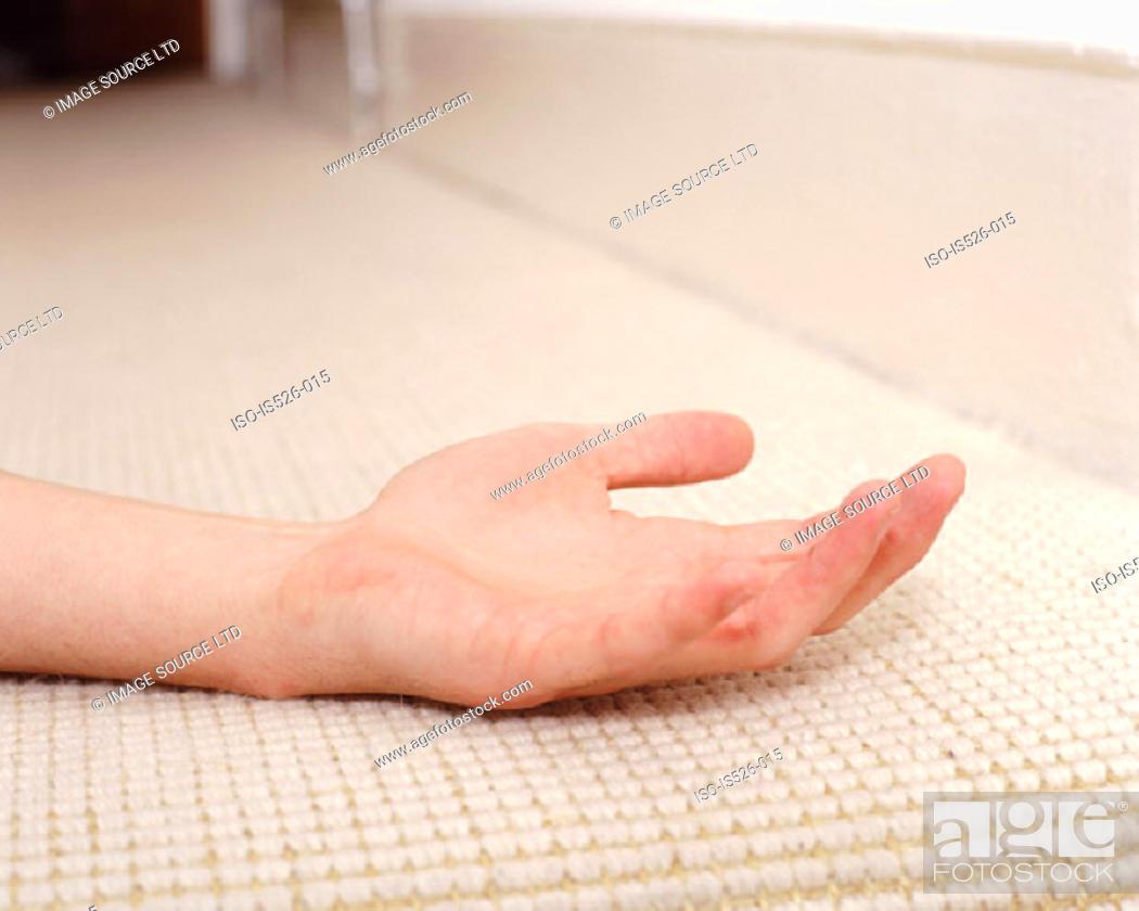 Stock Photo: Hand on carpet.