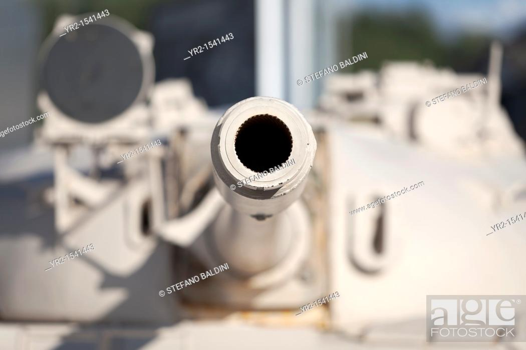 Stock Photo: Looking down the barrel of a gun on an old tank, a russian made T-55 at the imperial war museum in Manchester, England.