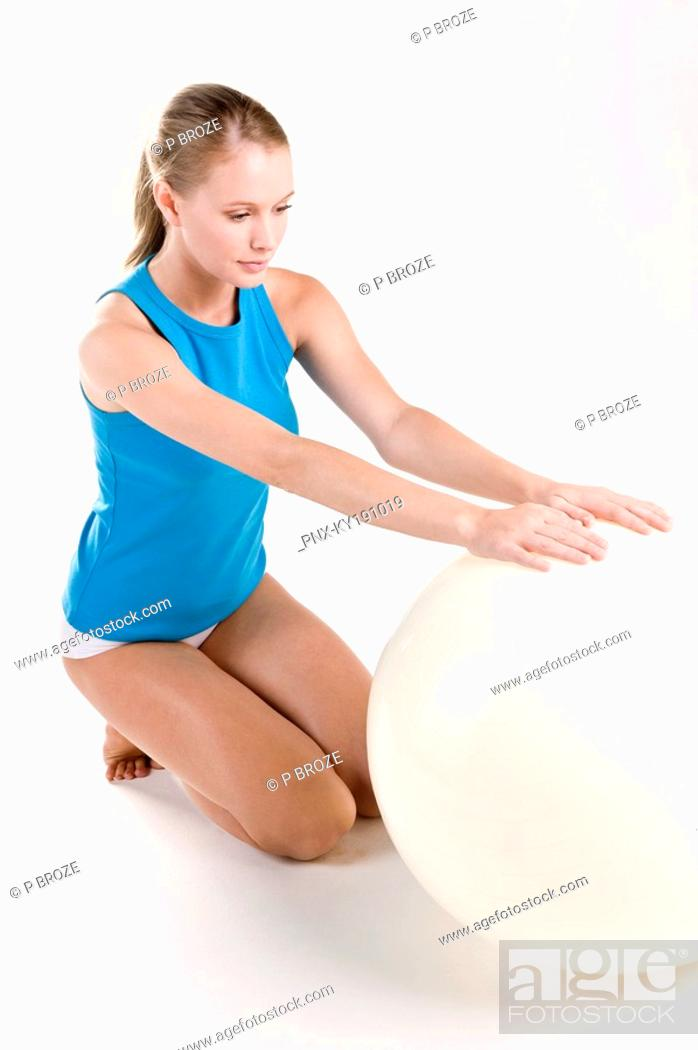 Stock Photo: Woman exercising with a fitness ball.